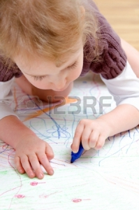 17416930-cute-little-girl-drawing-with-pencil